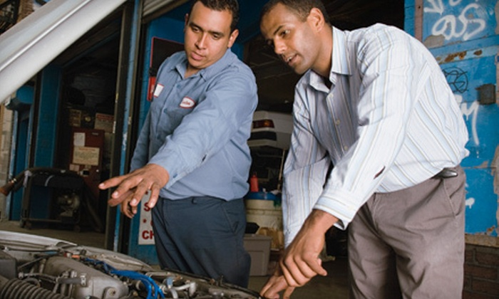 Columbia Auto Repair - Southwest Garden: State Safety and Emissions Testing or Oil-Change Package at Columbia Auto Repair (Up to 51% Off)