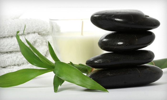 Essence Massage and Spa - Ottawa: Two Infrared Sauna Sessions or Permanent Eyelash Extensions at Essence Massage and Spa