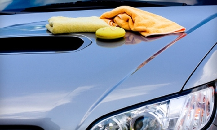Splash Zone Car Wash - Fitzgerald: $10 for Four Car Washes at Splash Zone ($20 Value) or $14 for Four Car Washes at Hurricane Bay ($28 Value). Four Locations Available.