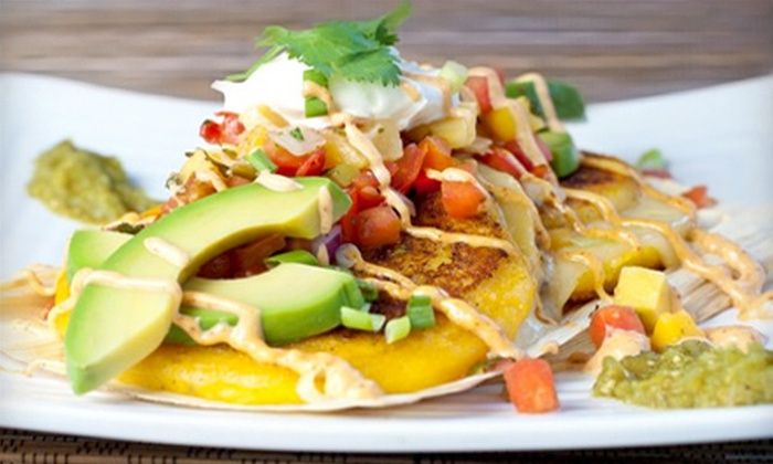 Mango Mangos - St. Augustine Beach: Caribbean Lunch or Dinner with Appetizer, Entrees, and Drinks for Two or Four at Mango Mangos in St. Augustine (53% Off)