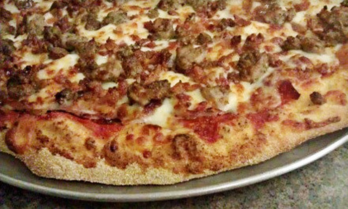 DC's Pizza & Subs - Baker Park: Pizzeria Fare at DC's Pizza & Subs in Elkhart (Half Off). Two Options Available.