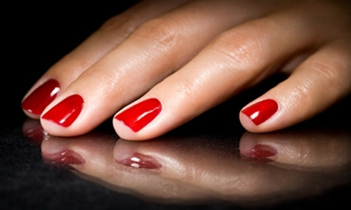 Luxury Nails and Hair - Airline/Jefferson: $27 for a Spa Mani-Pedi or $25 for a Set of Solar Nails with Paraffin-Wax Treatment at Luxury Nails