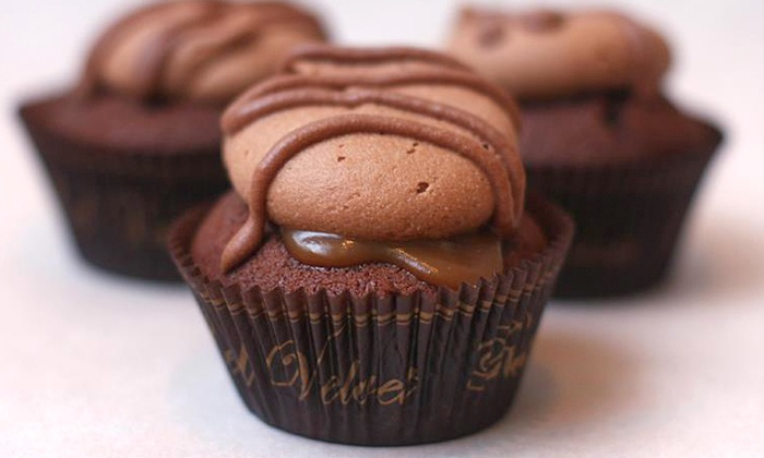 Red Velvet Cupcakery - Multiple Locations: $22 for One Dozen Assorted Cupcakes at Red Velvet Cupcakery ($39.60 Value)