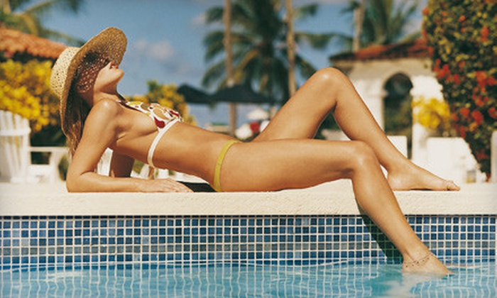 Tropical Tan Kenosha - Tropical Tan: One, Three, or Five Mystic Spray Tans or One Month of Tanning-Bed Sessions at Tropical Tan Kenosha (Up to 53% Off)