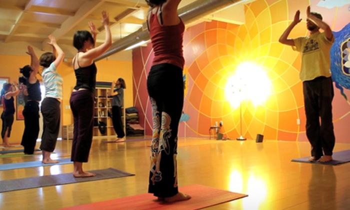 DiviniTree Yoga and Arts Studio  - Eastside: Five Yoga Classes or One Month of Unlimited Yoga Classes at DiviniTree Yoga and Arts Studio (Up to 80% Off)