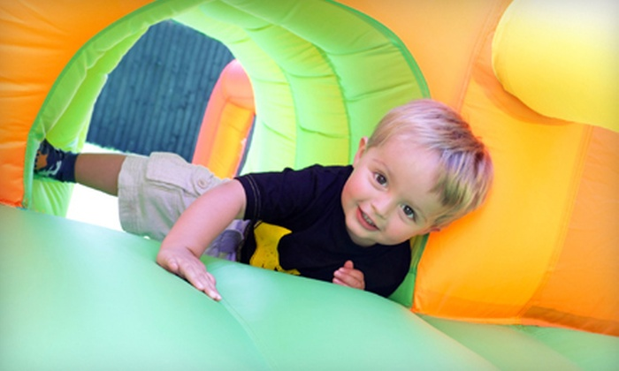 Inflatable Kingdom - Portland: $12 for Three Open-Play Passes and Toy Crown at Inflatable Kingdom (Up to $24 Value)