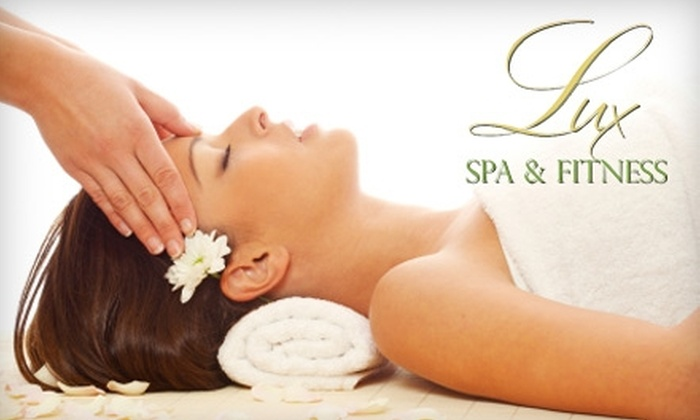 Lux Spa & Fitness - Center City East: $49 for a 50-Minute Massage ($100 Value) or $59 for a Facial ($130 Value) at Lux Spa and Fitness