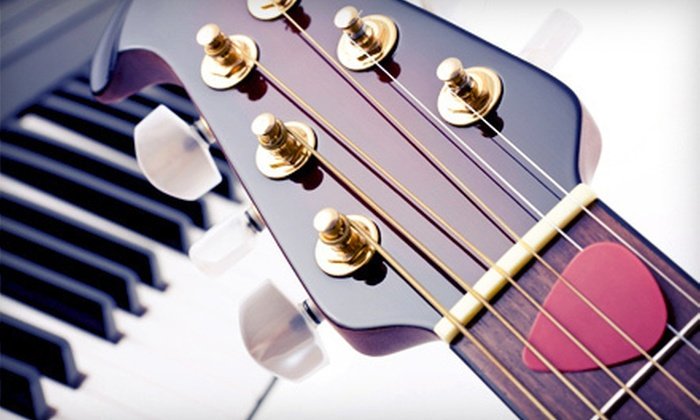 Guitar Cities Chicago - The Loop: Two, Four, or Six 30-Minute Private Guitar, Piano, Bass, or Ukulele Lessons at Guitar Cities Chicago (Up to 59% Off)