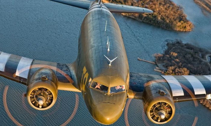 Greatest Generation Aircraft - Meacham Airport: Holiday-Lights Flight Tour in a Douglas C-47 for One or Two from Greatest Generation Aircraft (Up to 73% Off)