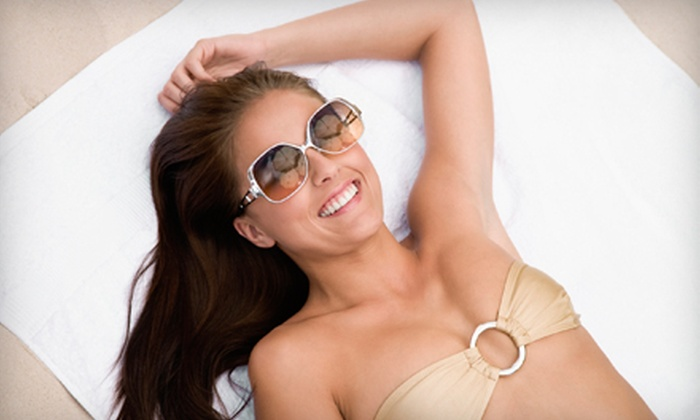 Secret Sun - High Point: One or Three Spray Tans or One Month of Unlimited Tanning-Bed Use at Secret Sun in High Point