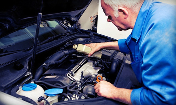 Countryside Service Center - Holliston: Two or Four Oil Changes with Tire Rotation, Balance, and Alignment at Countryside Service Center (Up to 71% Off)