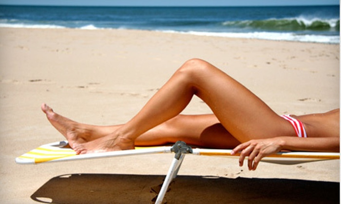 Hollywood Tans - Chantilly: Two Spray Tans or One Month of Unlimited UV Tanning at Hollywood Tans (Up to 52% Off)