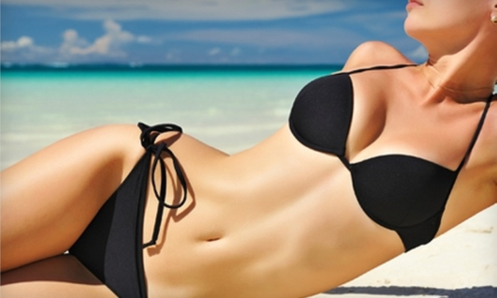 Body FX Tanning Salon - Multiple Locations: Three Bed Tanning Sessions or Four Mystic Tan Spray Sessions at Body FX Tanning