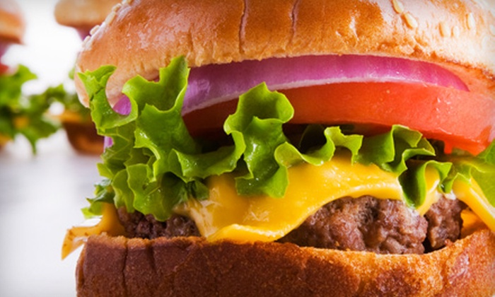 Strikerz Bar & Grill - Saint Peters: $10 for $20 Worth of Casual Grill Fare and Drinks at Strikerz Bar & Grill at Brunswick Zone XL in St. Peters