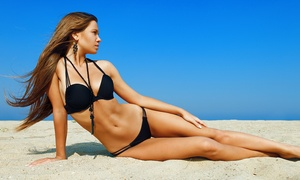 Lux Tan: Heated Airbrush Tan, Light-Level Spray Tan, or One Month of Red-Light Therapy at Lux Tan (Up to 81% Off)