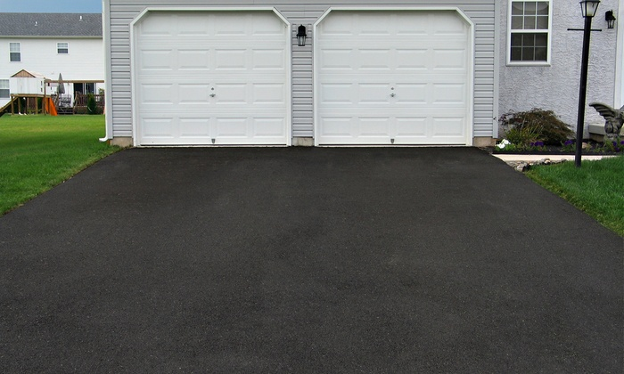 College Fund Pressure Washing - Lakeland: Pressure Washing of a One- or Two-Care Driveway from College Fund Pressure Washing (Up to 68% Off)