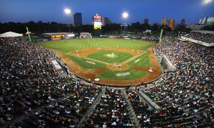 Sacramento River Cats vs Reno Aces - Raley Field: Sacramento River Cats Game for Two at Raley Field on April 20, 22, or 23 (Half Off). Two Seating Options Available.