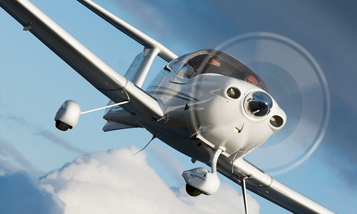 Blue Line Aviation LLC - Multiple Locations: Discovery Flight for up to Two or a Flight-Training Package for One from Blue Line Aviation LLC (Up to 48% Off)