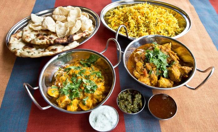 Menú para 2 o 4 con aperitivo, entrantes, principales, acompañamientos, postre y bebida desde 19,95 € en Taste of India