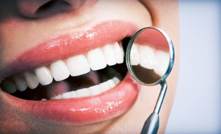 $39 for Comprehensive Dental Exam with X-Rays and Teeth Cleaning at American Dental of Florida (Up to a $275 Value)