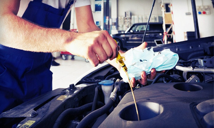 Auto-Lab - Saint Clair Shores: Three Oil Changes with Tire Rotations and Inspections or a Winter-Ready Package at Auto-Lab (Up to 63% Off)