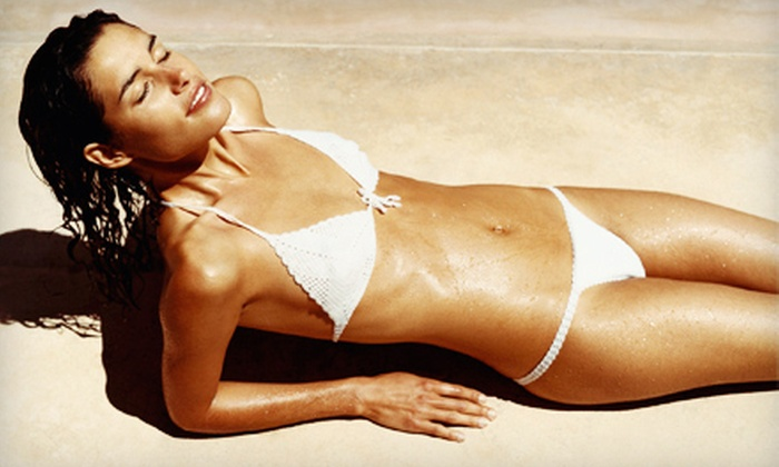 Island Sun & Bronz Beauty - Multiple Locations: One Month of Unlimited UV Tanning or One or Three Spray Tans at Island Sun & Bronz Beauty (Up to 69% Off)