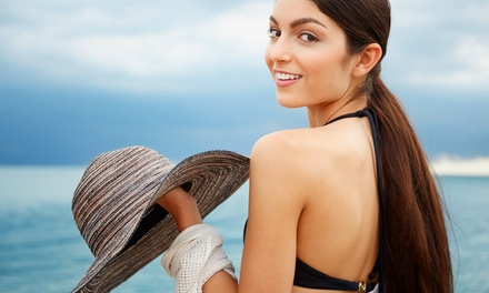 One Month of Level-One or Level-Five Ultra UV Tanning or Five Mystic Spray Tans at Tropical Tan (Up to 77% Off)