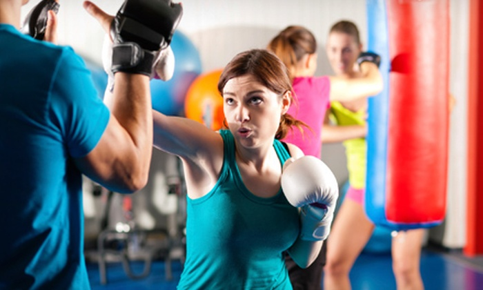 In Motion Fitness, Inc. - Multiple Locations: Massage, Group Training Classes, or Personal Training at In Motion Fitness, Inc. (Up to 65% Off). Four Options Available.