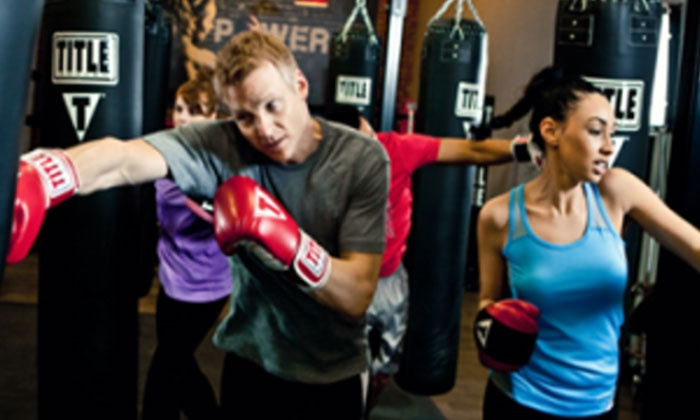 TITLE Boxing Club - Dallas- Frankford Rd: $19 for Two Weeks of Unlimited Boxing and Kickboxing Classes with Hand Wraps at TITLE Boxing Club ($45.49 Value)
