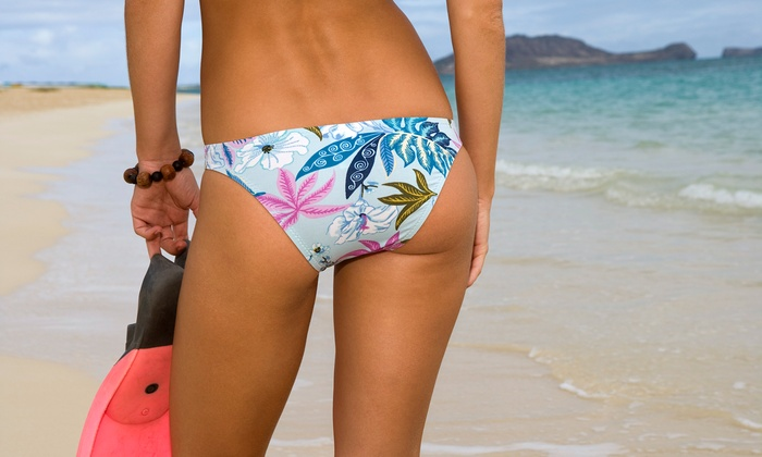 Ultra Tan - Arlington: Five UV Tanning Sessions or One or Two Custom Airbrush Tans at Ultra Tan (Up to 75% Off)
