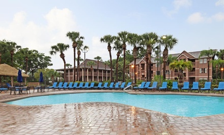 groupon daily deal - Stay with Wildlife Park Admission at Polynesian Isles in Kissimmee, FL; Dates into June