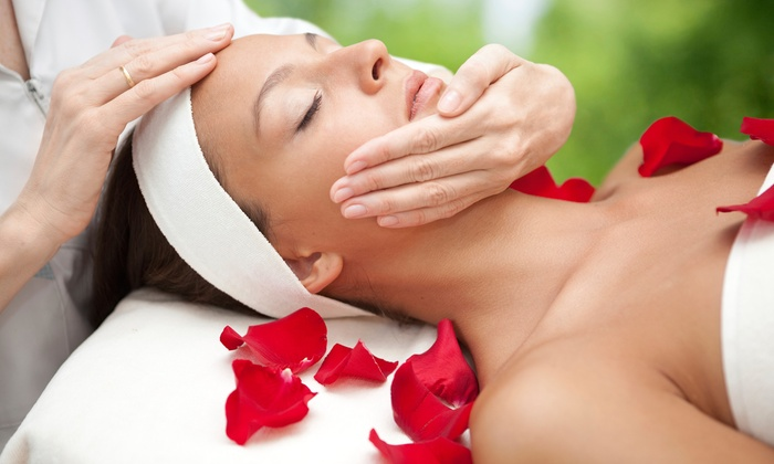 Pure Radiance Salon & Tanning - Woodward Park: $85 for a Spa Package with a Facial, Massage & Candle at Pure Radiance Salon & Tanning ($170 Value)