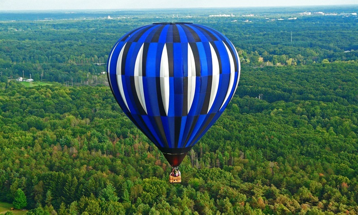 Magic Clouds Balloon Corporation - Level Park-Oak Park: Shared Hot Air Balloon Ride for One, Two or Four at Magic Clouds Balloon Corporation (Up to 22% Off)