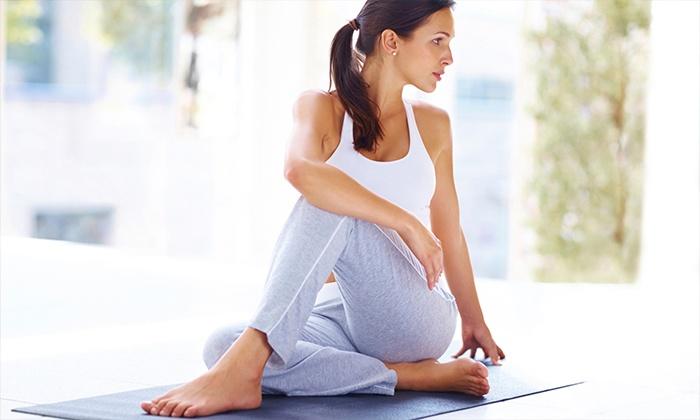 Dharma Hot Yoga - Midtown: 10 Yoga Classes, One Month of Yoga, or One Month of Classes and a Massage at Dharma Hot Yoga (Up to 77% Off)