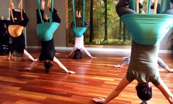 Uplift Yoga & Sound Healing Arts - Good Karma Center for Joy: Three or Five Aerial-Yoga Classes at Uplift Yoga & Sound Healing Arts (Up to 48% Off)