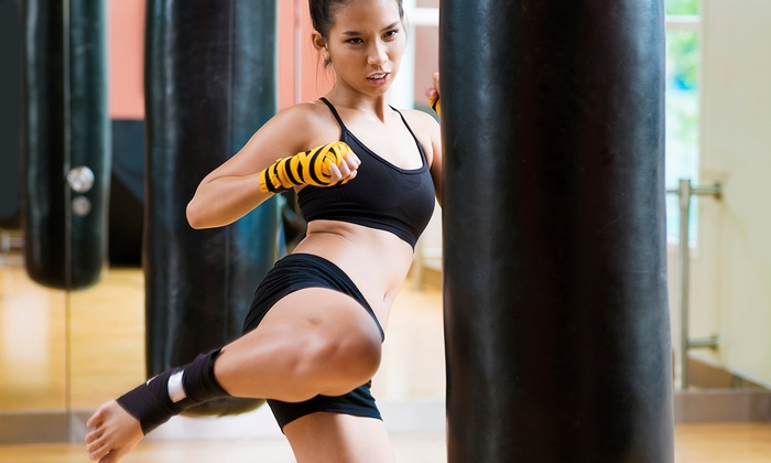 Amerikick - Multiple Locations: 5 or 10 Cardio-Kickboxing Classes at Amerikick (Up to 72% Off)