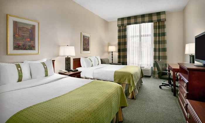Holiday Inn St. Louis—South County Center - Mehlville: Stay for up to Four with Dining Credit at Holiday Inn St. Louis—South County Center