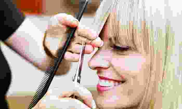 Pretty Du Hair Designs - Central Raleigh: $50 for $100 Torwards Keratin Treatments or a Partial Weave