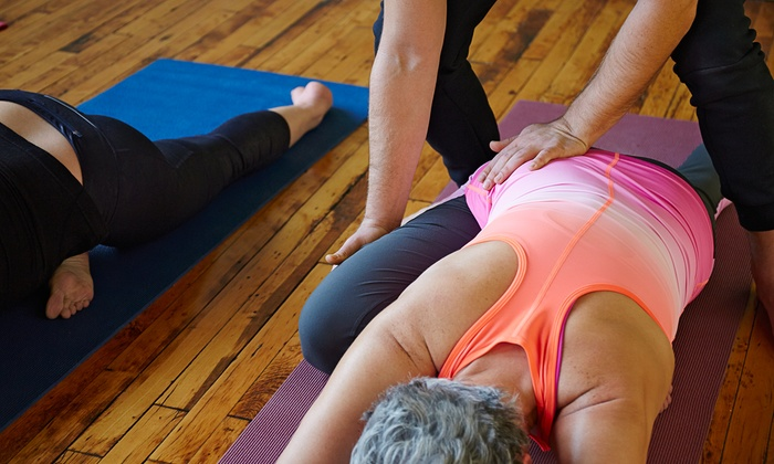 Southern Om Hot Yoga - Pleasantburg: $21 for Two Weeks of Unlimited Yoga Classes at Southern Om Hot Yoga ($80 Value)