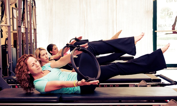 Pilates of Palm Beach - Boynton Beach: 10 or 20 Yoga or Pilates Mat Classes or Three Private Apparatus Sessions at Pilates of Palm Beach (Up to 64% Off)