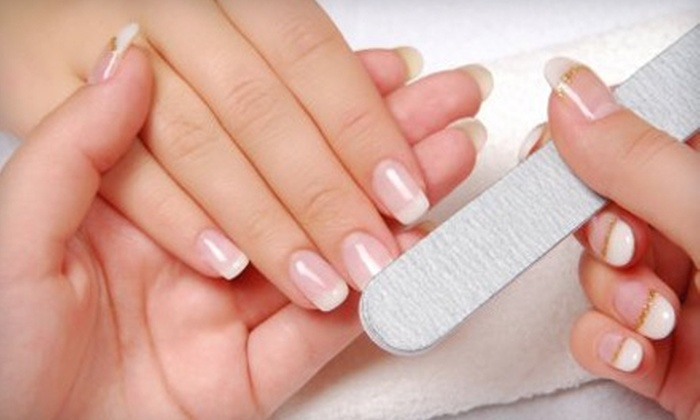 Skin Deep Salon & Spa - Coralville: $15 for a Manicure ($30 Value) or $25 for a Pedicure ($50 Value) at Skin Deep Salon & Spa