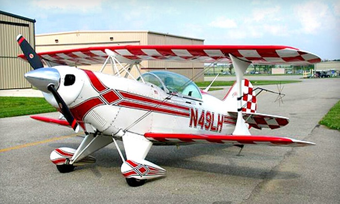 Four Winds Aviation - Aero Country Estates: $199 for an Aerobatic Airplane Thrill Ride from Four Winds Aviation in McKinney ($349.99 Value)