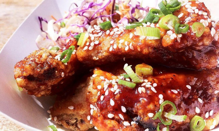 Bellybombz - Los Angeles: Korean-Inspired Wings, Sliders, Sides, and Beers for Two or Four at Belly BombZ (41% Off)
