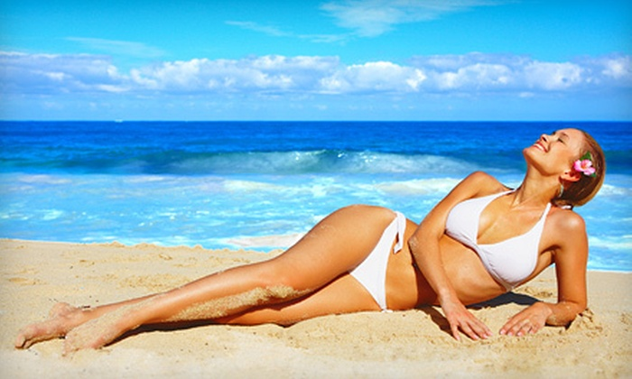 Tan-Tastic Tanning - Multiple Locations: Two or Four VersaSpa Spray Tans at Tan-Tastic Tanning (Up to 68% Off)