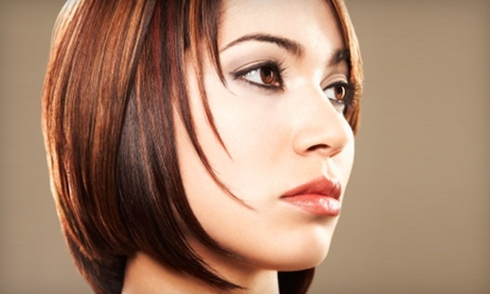 Lighten Up Day Spa - Amarillo: Haircut or Facial Waxing at Lighten Up Day Spa. Choose from Three Options.