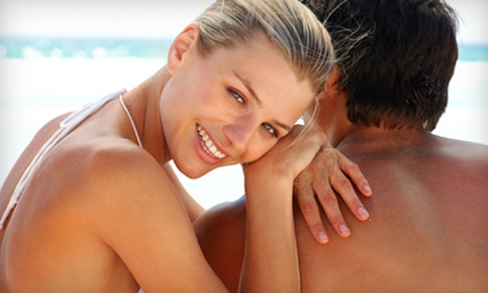Sun Tan City - Multiple Locations: Two or Four Sunless- or UV-Tanning Sessions at Sun Tan City (Up to 74% Off)