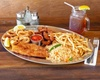 Up to 38% Off Dinner Package at Holy Smoke Grill