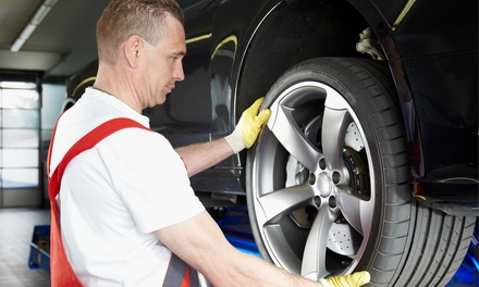 Tire Rotation and Balancing, or Brake Pad Replacement with Optional Oil Change at Grease Monkey (Up to 58% Off)