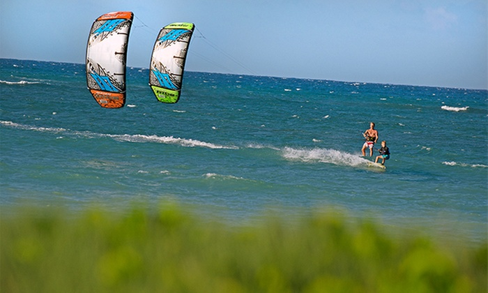Liquid Surf and Sail - Downtown Fort Walton Beach: Half-Day Standup Paddleboard or Kayak Rental, or Kiteboarding Lesson for Two from Liquid Surf and Sail (Up to 52% Off)