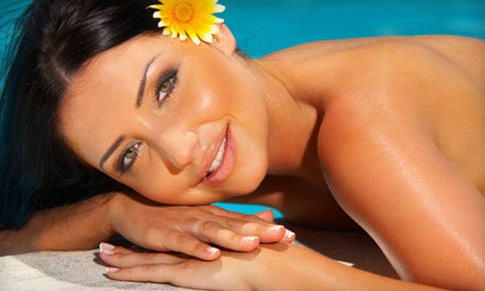 Extravaganza - Memphis: One or Three Full-Body Spray Tans or Holiday Airbrush Makeup at Extravaganza (Up to 59% Off)